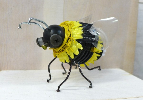 Small bumblebee sculpture made from recycled materials
