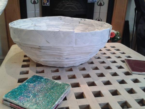 This is made with recycled newspapers , it is strong as it is coated with Gesso .