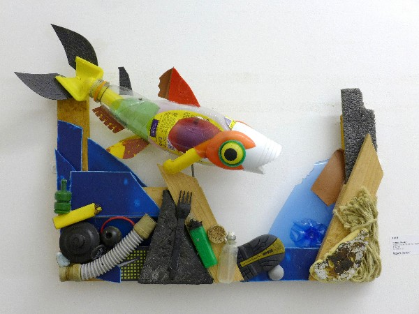 Wall mounted fish sculpture made from litter found in the River Thames