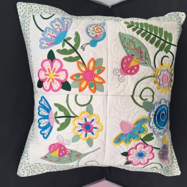 Elegant Embroidered, appliquéd and quilted cushion