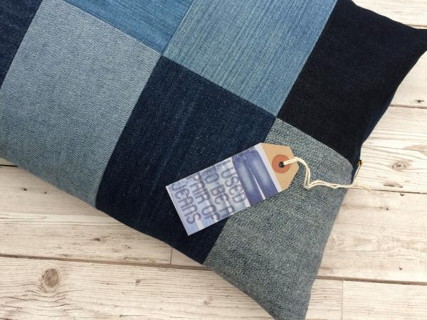Cushion of patchwork recycled vintage denim jeans